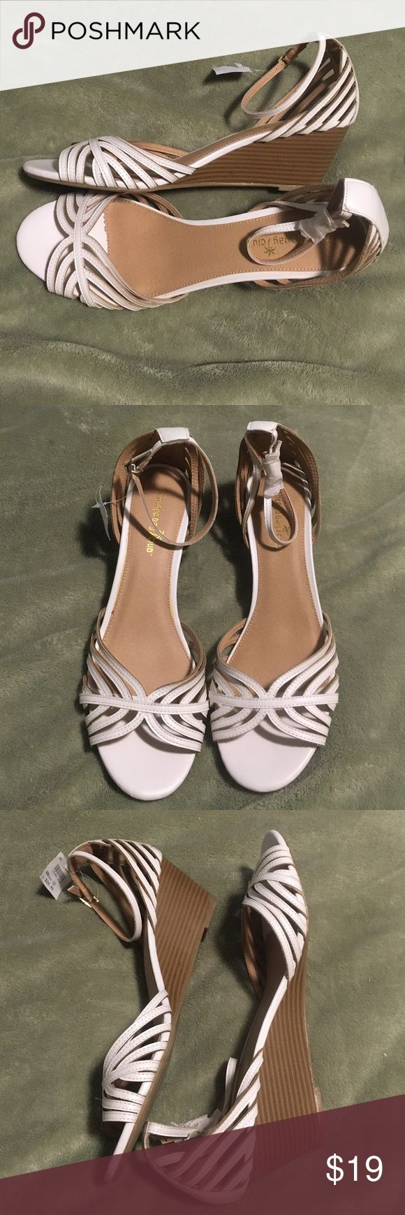 """NEW size 12 wedge shoes These shoes are brand-new with tag attached regular price $39.99. They are a size 12 and brand is Montego Bay club. Wedge is 2.5"""". Has ankle strap. montego Bay Club Shoes Wedges"""