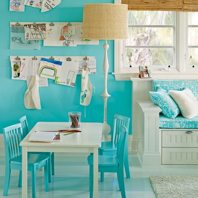 Amp Up Kids' Rooms: This playroom gets shots of color from Benjamin Moore's Tropicana Cabana on the walls and a Dek Tillett fabric on the banquette. Clips on the wall make it easy to showcase artwork and change out pictures. | CoastalLiving.com
