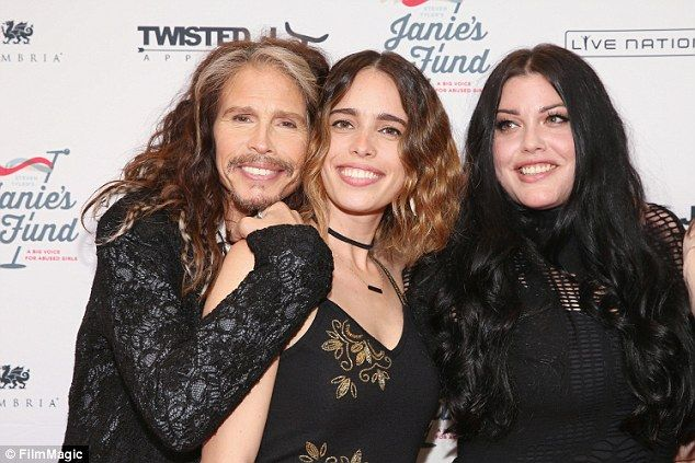 Homage: The 27-year-old (pictured center with her father and sister Mia Tyler), who walked...