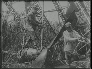 The wreckage of Zeppelin LZ85, brought down in the marshes near Salonika, 5th May 1916. Link to film short. Crew are taken prisoner.