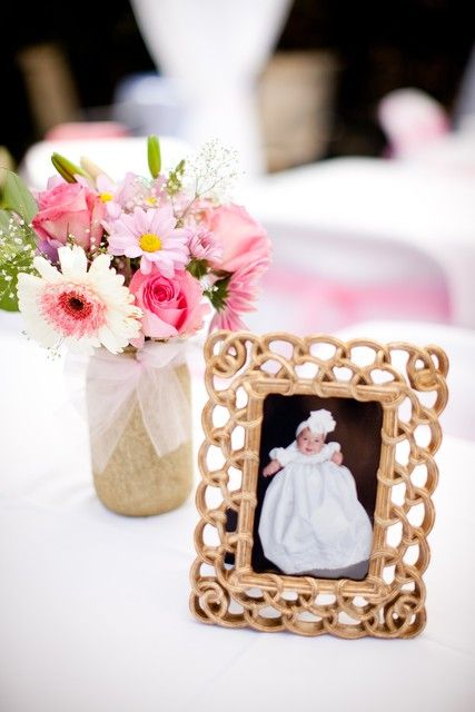So easy to incorporate a framed photo as part of your baptism table centerpieces.  The frames would be nice favors too.