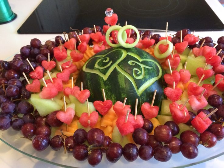 Watermelon fruit tray with wedding rings. Rings made from a cucumber.
