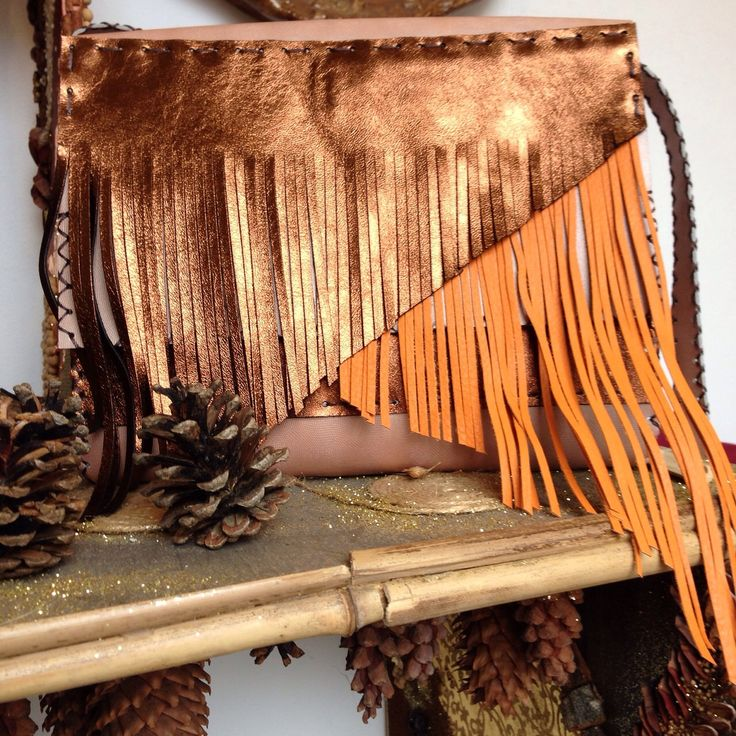 Pearl brown and orange leather bag accessorized with layered fringes. #handmade #cool #fringes #bag