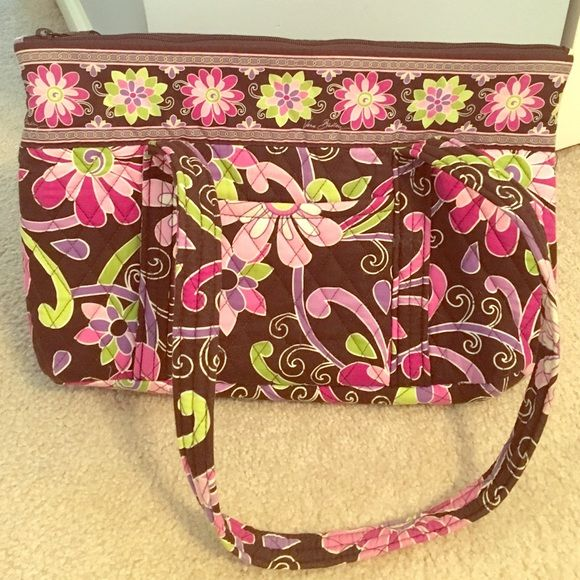 NWOT Vera Bradley tote bag Vera Bradley tote bag. Never used. One slot pocket on front and six slot pockets inside. Perfect for spring or summer. Reasonable offers considered. Vera Bradley Bags