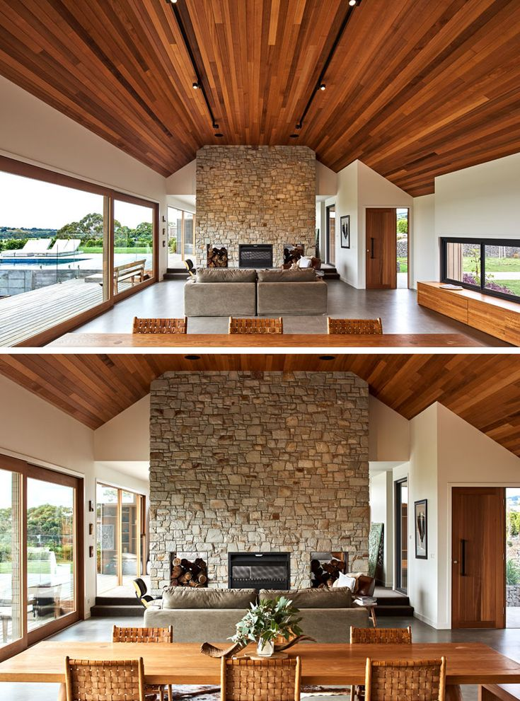 A large wood cathedral ceiling and a stone fireplace are the focal points in this modern house interior. #CathedralCeiling #StoneFireplace #ModernInterior #InteriorDesign