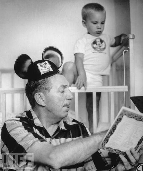 Walt Disney reads his grandson a story, 1955. (Life Magazine Photo)