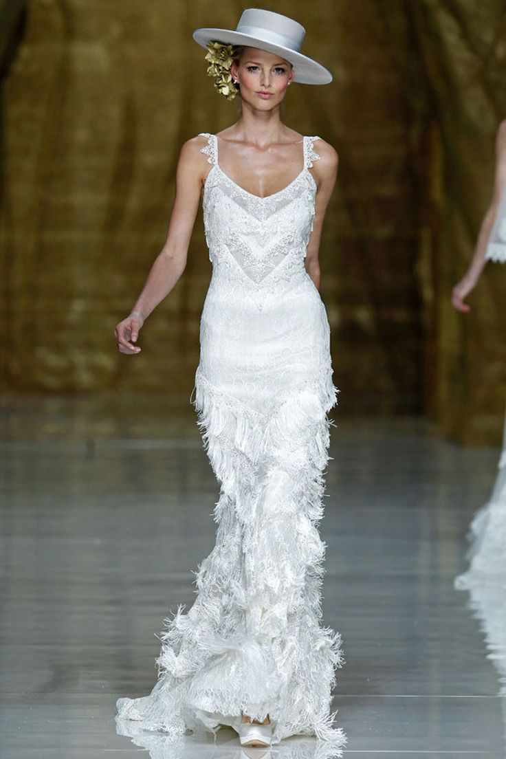 Flamenco Dress: Sleeveless white lace and fringe with train. This would be awesome in red with no train.