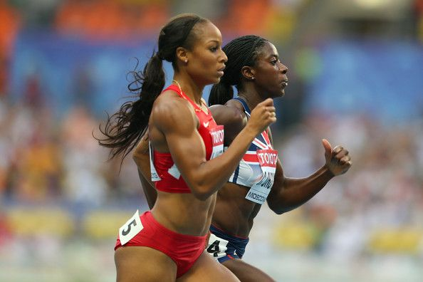 (L-R) Natasha Hastings of the United States and Christine Ohuruogu of Great Britain compete in the Women's 400 metres semi final during Day Two of the 14th IAAF World Athletics Championships Moscow 2013 at Luzhniki Stadium on August 11, 2013 in Moscow, Russia.