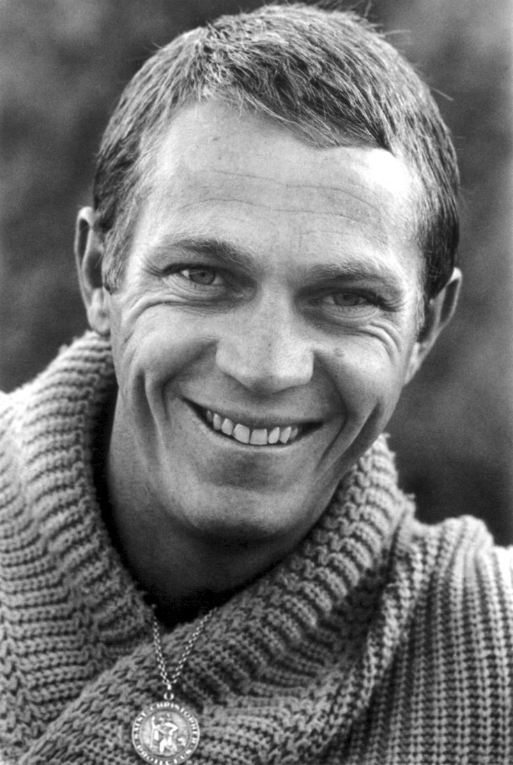 Steve McQueen is all smiles for this 1960s photo, where the actor is purchased in a shawl neck sweater.