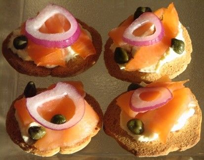 Smoked salmon appetizer with cream cheese, capers, and red onion.