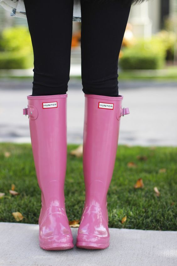 The perfect pop of pink! Check out these bright pink hunter rain boots!
