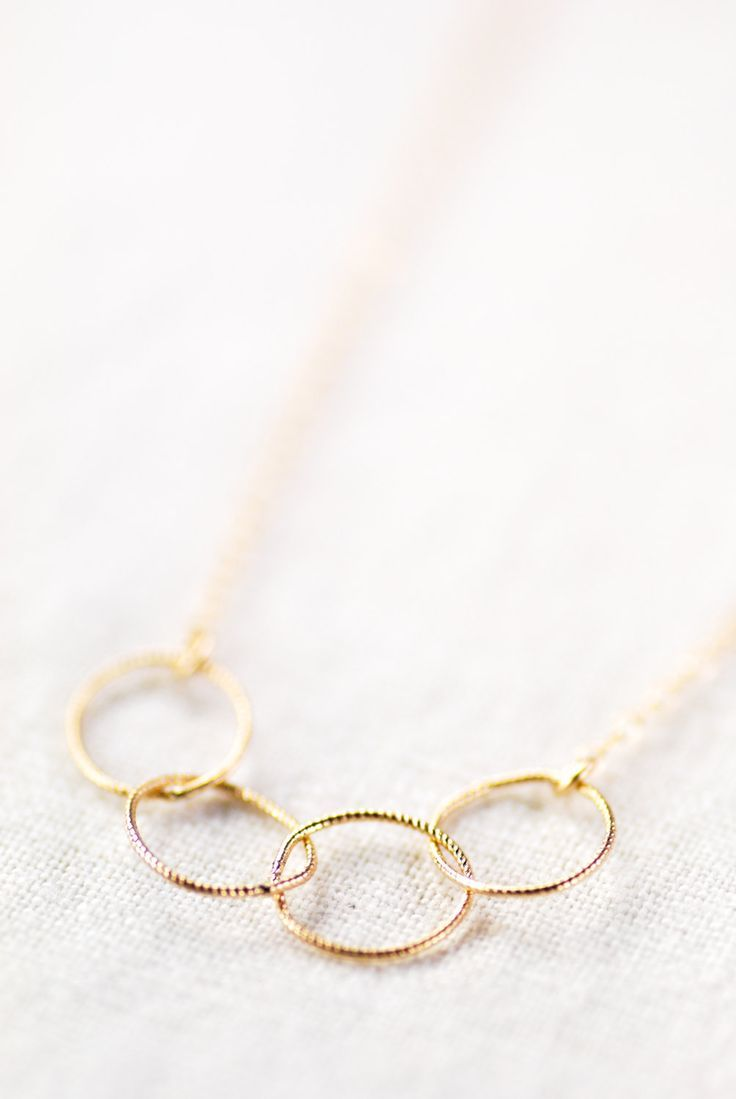 delicate gold necklace with infinity circle links
