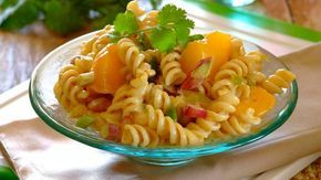 CURRIED PEACH NOODLE SALAD •250 g pasta noodles •15 ml sunflower oil •1 onion, finely chopped •1 green pepper, finely chopped •15 ml Raj...