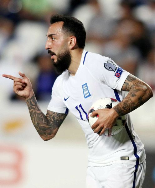 Greece's forward Konstantinos Mitroglou celebrates his equalising goal during their World Cup 2018 qualifying Group H football match between Cyprus and Greece at the NEO GSP Stadium in Nicosia on October 7, 2017.  / AFP PHOTO / SAKIS SAVVIDES
