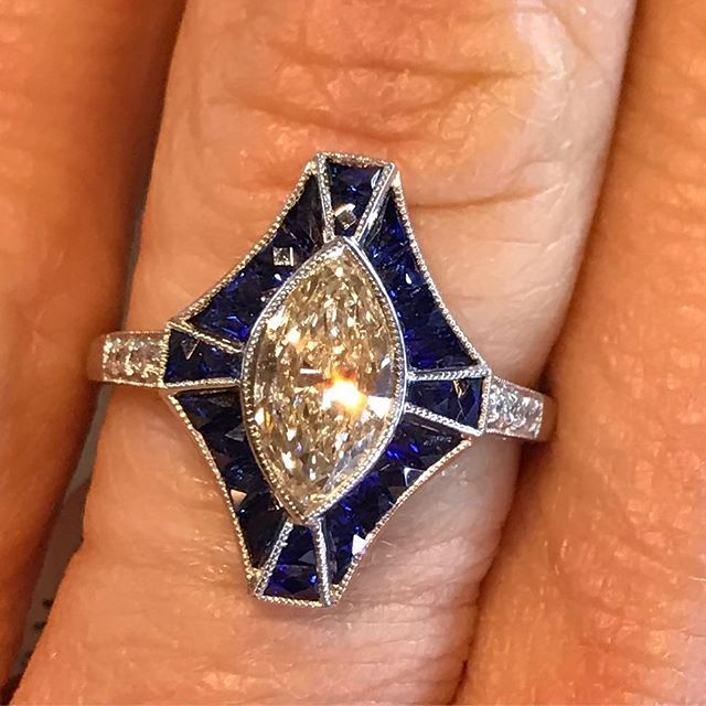 Art deco Marquis ring with sapphire halo