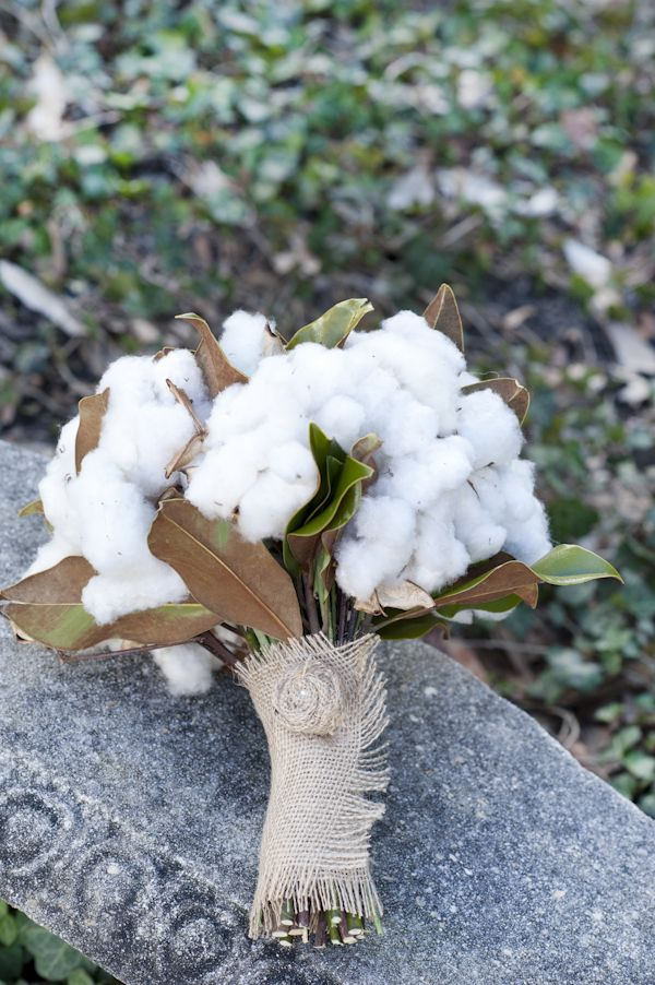 cotton and magnolia leaf bouquet wrapped in burlap