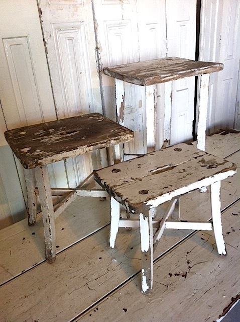 Shabby white stools.  Would be soo pretty with lush potted greenery!  SW