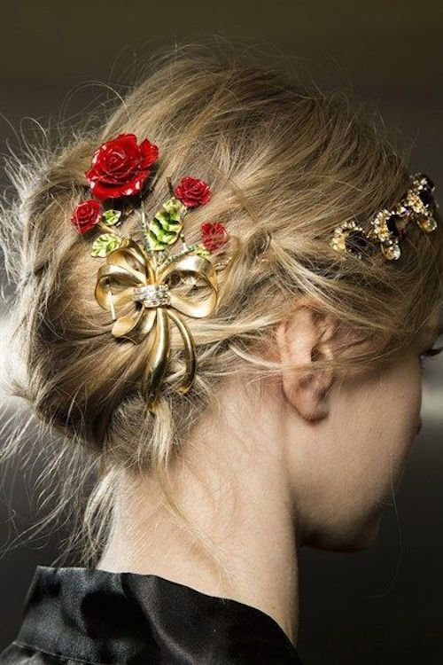 Lovely wedding hairstyle with gold and rose hair accessory. Via Glamour Magazine: