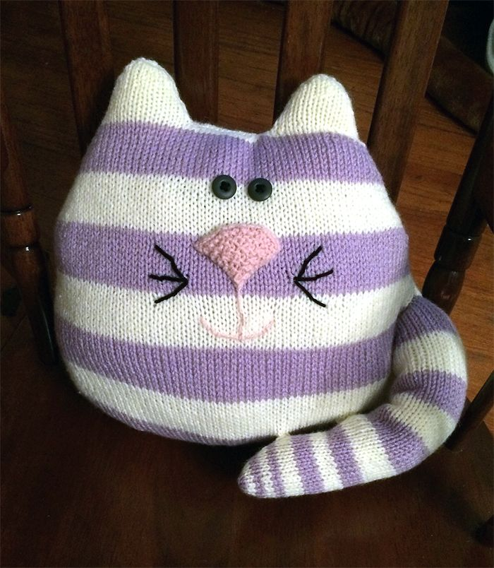 """Free Knitting Pattern for Cat Cushion - Easy cat shaped pillow. If knit in aran weight yarn, the size is 18"""" x 13"""" excluding ears. Rated easy by Ravelrers. Designed bySue Speechley forGranny's World. Pictured project bylaurelm78"""
