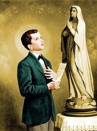 Saint Dominic Savio look with at a statue of Our Lady