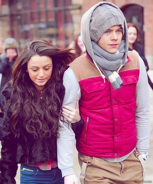 i love how harry styles is all huddled up and cher lloyd is only in a little jacket... hehe