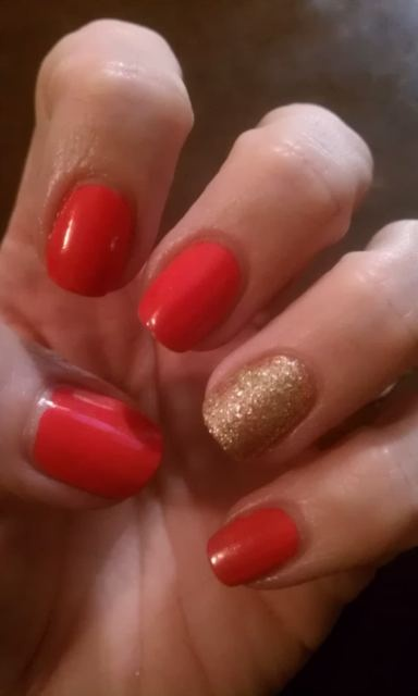 Sally Hansen's Kookamango with a gold glitter ring finger