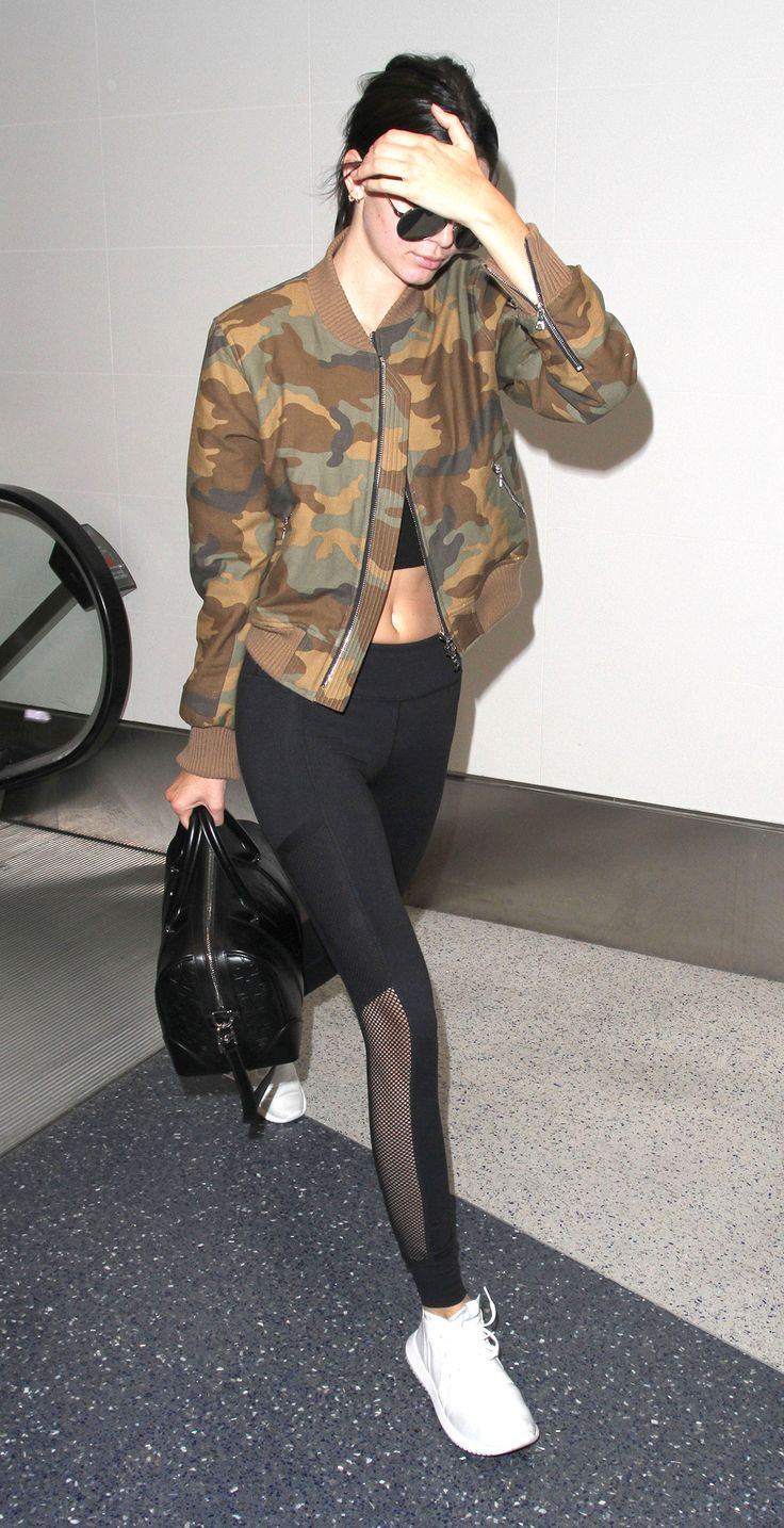 Mesh-insert leggings? Check. Fresh white trainers? Check. It bag? Check. Pap-proof shades? Check. Must-have camo bomber jacket? Check, check, check! Kendall Jenner certified: camo print is here to stay.