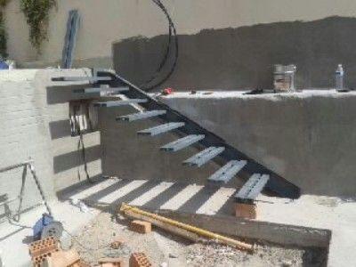 Escalera metalica volada sin vigas escaleras for Calculo escalera metalica