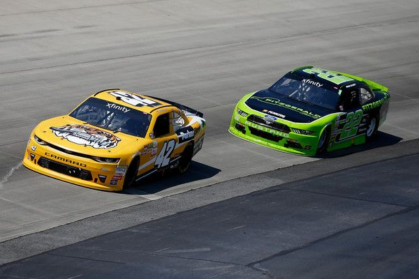 Ryan Blaney Photos Photos - Kyle Larson, driver of the #42 Parker Store Chevrolet, races Ryan Blaney, driver of the #22 Fitzgerald Ford, during the NASCAR XFINITY Series OneMain Financial 200 at Dover International Speedway on June 3, 2017 in Dover, Delaware. - NASCAR XFINITY Series OneMain Financial 200