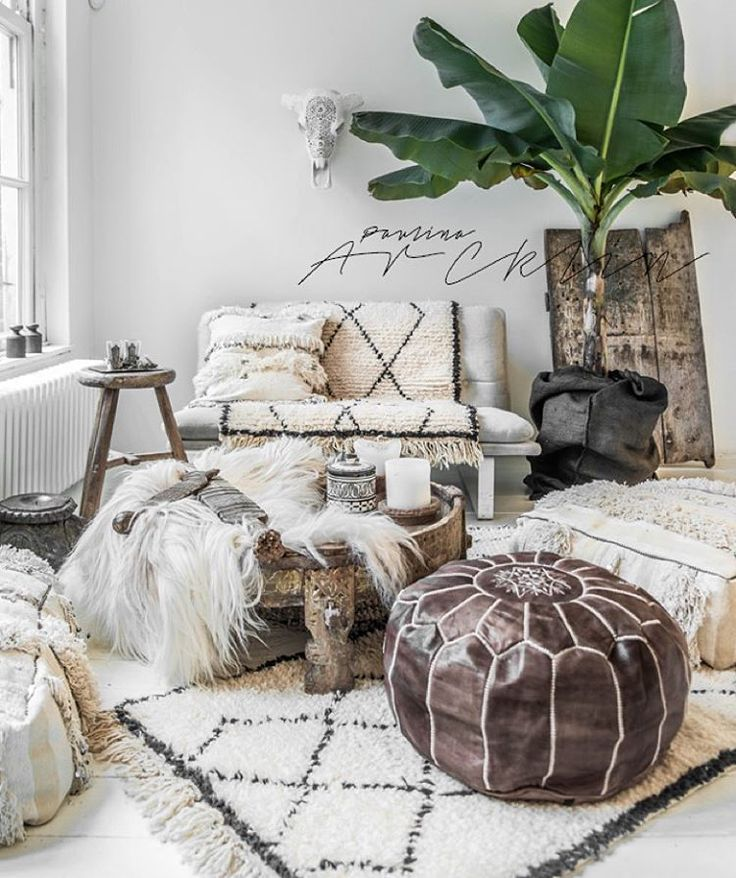 L O V E this beautiful home decor. Boho chic. Similar leather poufs can be found here - http://www.casablancamarket.com/collections/moroccan-poufs-ottomans