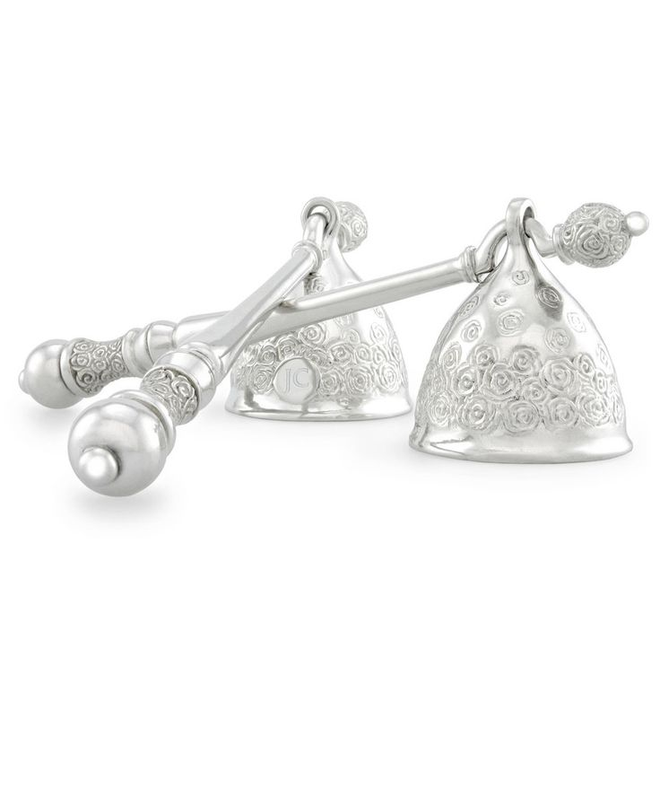Add romance and warmth to a cold winter evening with lots of candles. Elegant Rose Candle Snuffer by Jenna Clifford