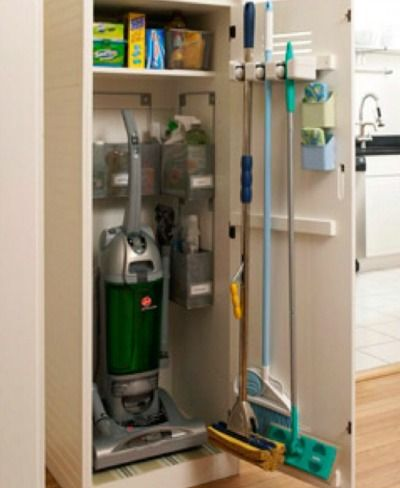 Home Organizing Ideas -- Well-Organized Broom Closet has cleaning supplies together with broom, mop, and vacuum cleaner