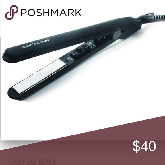 Corioliss Baby SXE Titanium Straightener in Black Small, Lightweight and dependable. With Automatic Dual voltage circuitry for global travel. Heats up to a constant 200°C/395°F in 30 seconds. Negative ion technology eliminates frizz and static. Exclusive titanium technology. Perfect for touch ups,fringes and detailed root styling including male styling. Comes in original packaging and with warranty and safety instructions booklet. Corioliss Accessories Hair Accessories