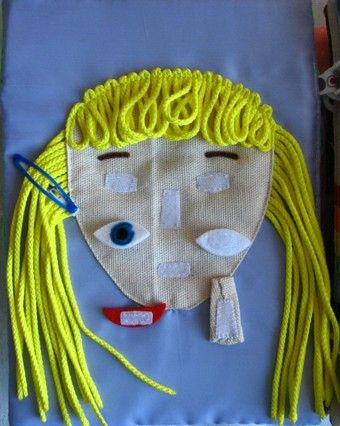quiet book- velcro face with pieces missing