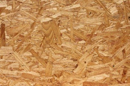 Oriented strand board might seem difficult to paint, but with the right materials, anyone can give this job a professional touch.