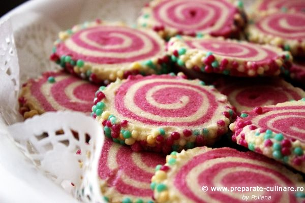 Colorful spiral cookies, adorable, perfect for Christmas or kids parties. Recipe from Sprinkle Bakes.