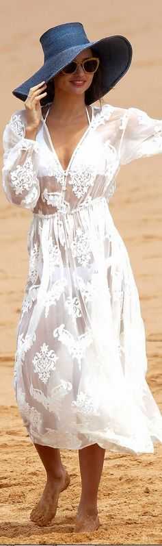 Who made Miranda Kerr's blue hat, white lace dress, and cat sunglasses that she wore in Sydney on February 10, 2013?