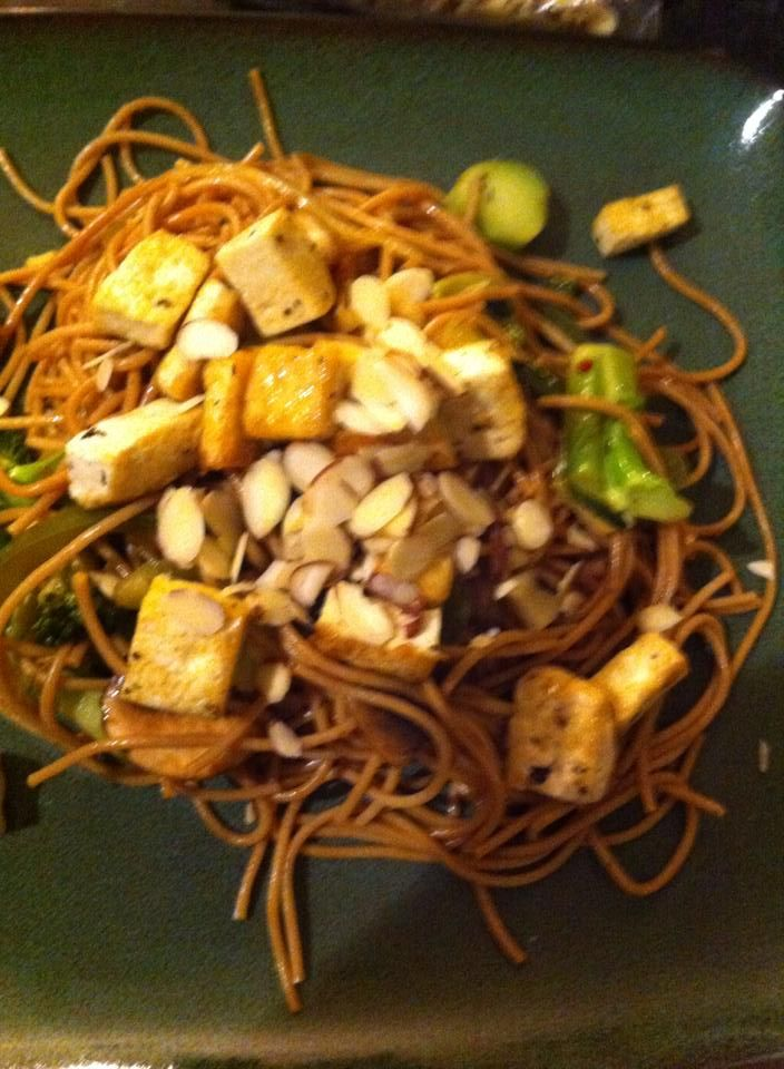 Whole wheat pasta with Tofu, almonds and yummy sautéed vegetables.