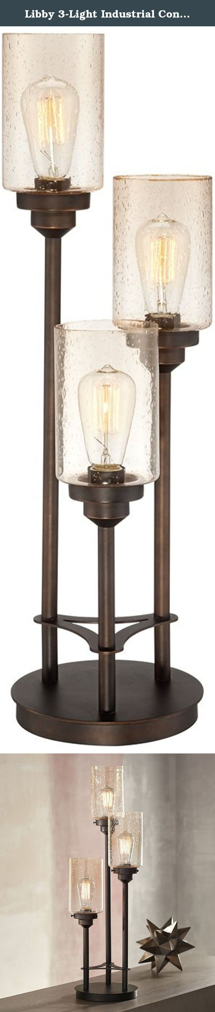 Libby 3-Light Industrial Console Lamp with Edison Bulbs. Add vintage industrial style to your home with this three tiered console lamp. The design features three bronze finish pillars at varying levels and beautiful amber seeded glass shades. Three antique-look Edison style bulbs are included to reinforce this eye-catching design's stylish and industrial feel. - Libby 3-Light Console Lamp. - Amber seeded glass shades. - Round base with three lamp arms. - Metal construction. - Bronze…