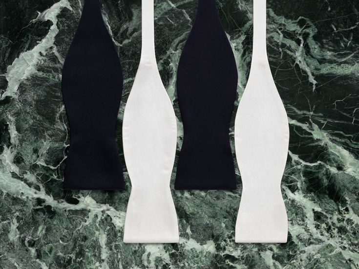 White and black bow ties. Designed by Yorgo stratouris