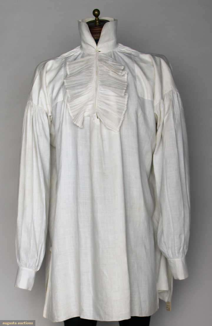 MAN'S WHITE LINEN SHIRT, AMERICA, c. 1800  Lot: 180 November 13, 2013 - NYC New York City V front w/ ruffles, fine linen w/ fold down collar, very good; t/w 1 cotton shirt w/ band collar & pleated bib, (bib on L side only) fair.   Price Realized: $ 1320.00 Category: Gents Era: 1800-1850 29.13482.240.180