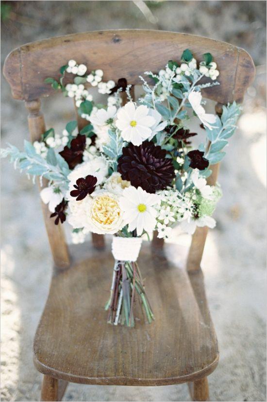 rustic wedding bouquet with hints of black #bouquet #weddingflorals #weddingchicks http://www.weddingchicks.com/2014/02/25/majestic-beach-wedding-ideas/
