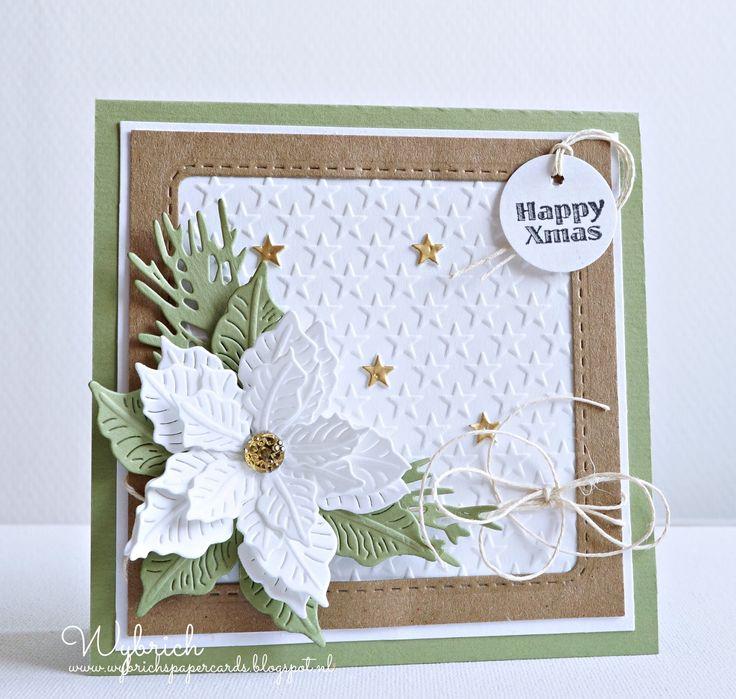 Een klein kerstkaartje met gouden sterretjes en een witte poinsettia. Op de witte geemboste achtergrond een paar gouden sterretjes. Een open...