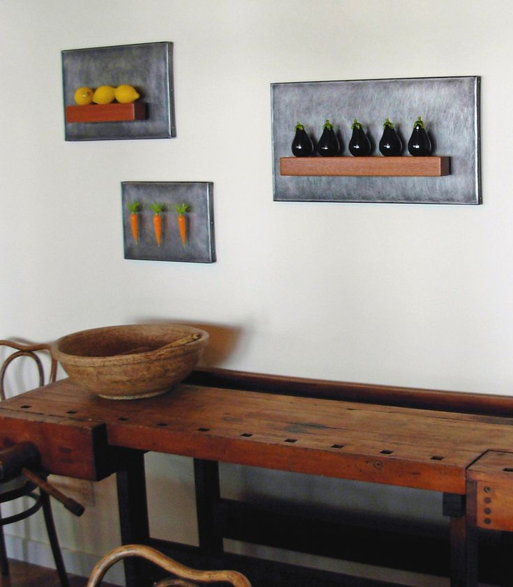 Art Glass, Minnesota dining room featuring a wonderful grouping of Jen Violette still-life wall sculptures that combine hand blown glass fruits and vegetables with stainless steel and mahogany.