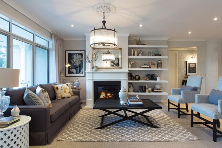 Formal lounge with fireplace in the Classic Hamptons interior style by World of Style