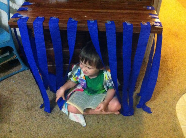 Reading about Joseph in prison, while sitting in his crepe paper jail.