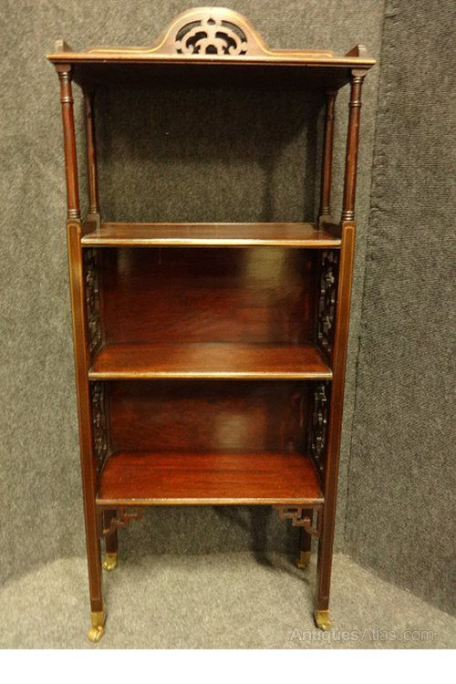 A very pretty early C20th mahogany bookcase of small proportions with brass inlays, fretwork panelled sides and arched gallery top, brass castors, in very good original condition.