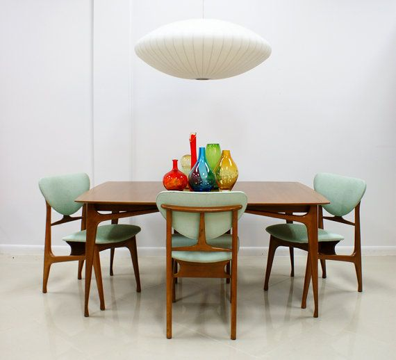 Nelson (-ish?) lamp hovering over a Danish modern dining set like a UFO.