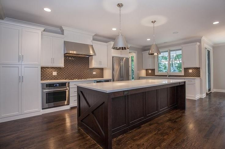 White and brown kitchen features white shaker cabinets paired with white quartz countertops and brown arabesque tiled backsplash.