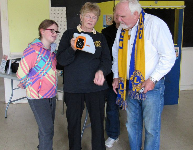 Lion Betty demonstrates the new vision screening equipment provided by A16 Vision Committee